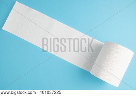 Partially Unrolled Toilet Paper Roll Isolated On Blue Background