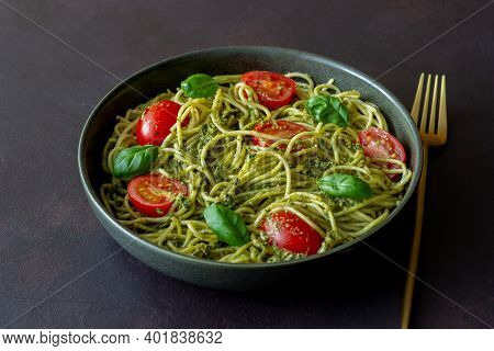 Pasta Spaghetti With Pesto Sauce, Tomatoes And Basil. Healthy Eating. Vegetarian Food