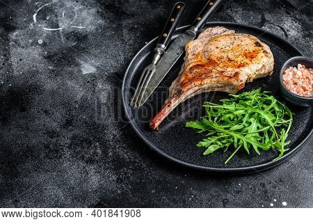Bbq Grilled Tomahawk Pork Chop Meat Steak On A Marble Board. Black Background. Top View. Copy Space