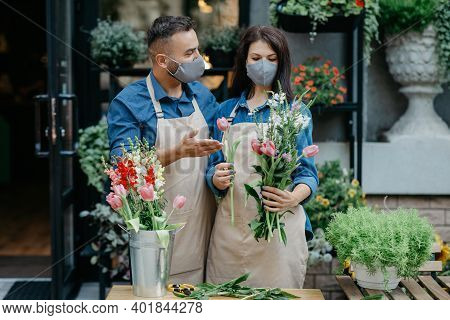 Creative Occupation In Floral Boutique And Social Distance. Busy Millennial Man And Woman In Aprons
