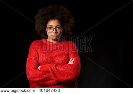 Offended Sulking Young African-american Girl In Glasses With Folded Hands