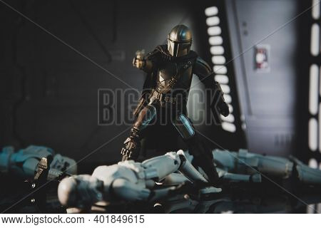 JAN 1 2021: a recreation of a scene from Disney Plus series Star Wars The Mandalorian with Din Djarin blasting Stormtroopers- Hasbro action figures