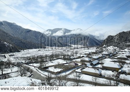 Mountain View Of The Village. The Leaves Of The Trees Fell On The Mountain. It Snowed In The Mountai