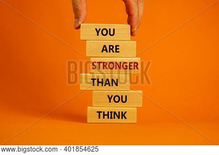 You Are Stronger Than You Think Symbol. Male Hand. Wooden Blocks Tower With Words 'you Are Stronger