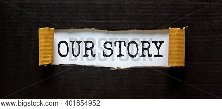 Our Story Symbol. Words 'our Story' Appearing Behind Torn Black Paper. Business And Our Story Concep