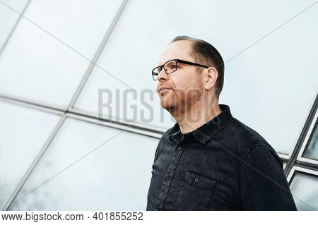 Portrait Picture Of A Young Business Man Looking Fo A Vision