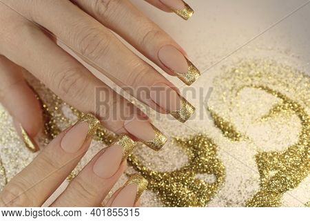 Golden Fashionable French Manicure On Long Nails With Sequins.