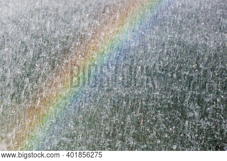 Picture With A Rainbow Appearing In The Spray Mist Of A Fountain