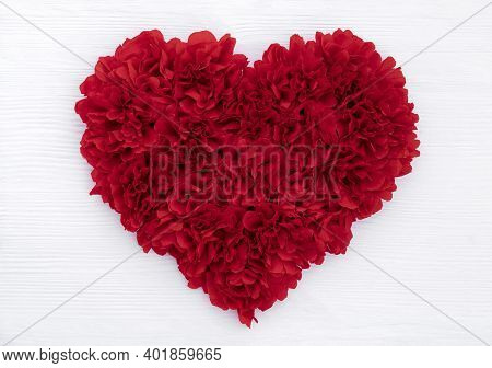 Deep Red Heart Made Of Crepe Paper On A White Background Of Brushed Wood For Congratulations On Vale
