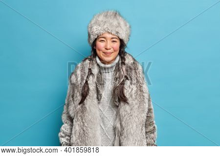Pleased Young Eskimo Woman Has Rouge Cheeks From Frost Two Long Pigtails Dressed In Sweater Fur Coat