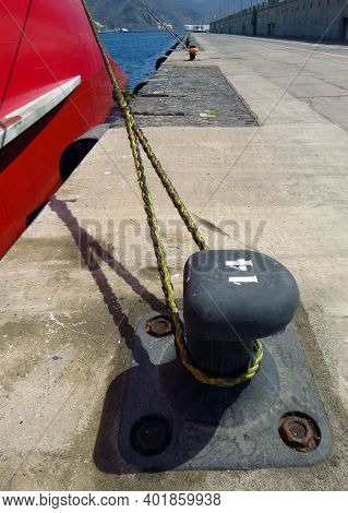 Mooring Bollard With Heavy Duty Mooring Ropes. Detail Of Mooring With The Rope Of The Boat In The Do