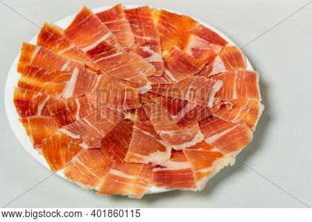 Detail Of A Plate Of Ham Cut With A Knife. Super Foods. Delicious Appetizer. Typical Spanish Food Co