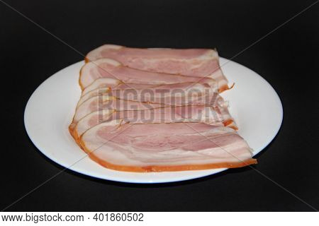 Sliced Smoked Meat On White Plate. Thin Slices Of Sliced Bacon. Plate Of Thin Slices Of Ham. Food Ap