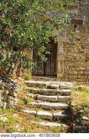 A Door In The 13th Century Church Pieve Di Santa Cristina In The Historic Village Of Rocchette Di Fa