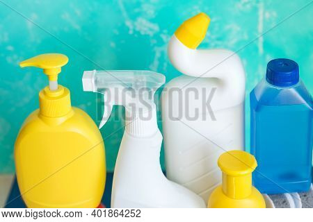 Detergent Bottles And Chemical Cleaning Supplies Isolated On Blue Background.home Cleaning Products.