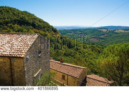 A View Of The Landscape Over Rooftops In The Historic Medieval Village Of Rocchette Di Fazio Near Se