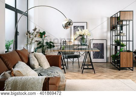 Home Office In Living Room With Modern Interior Design, Comfort Sofa, Laptop Computer, Paper Documen