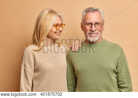 Happy Senior Woman Leans On Shoulder Of Husband Have Pleasant Talk Expresses Love And Support Pose T
