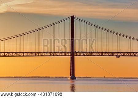 25 De Abril Bridge In Lisbon, Portugal, At Sunrise