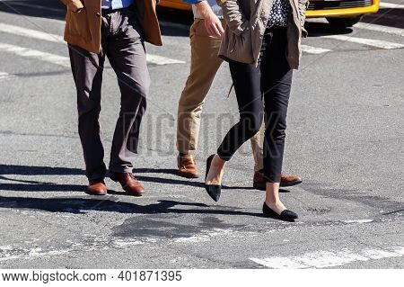 Business People Walking On A City Road