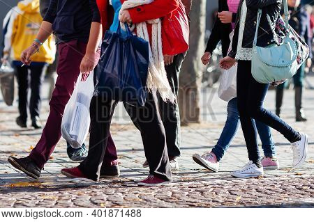 Crowd Of People With Shopping Bags In The City