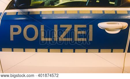 German Police (german: Polizei) Sign In White Letters On A Police Car