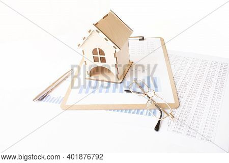 House Model On White Wooden Table Near Contract And Glasses, Real Estate Concept