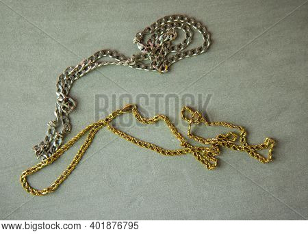 A Gold Necklace And A Silver Necklace