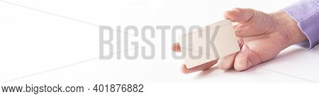 Male Hand Paying With The Credit Card Isolated On White Background