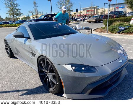 An Aston Martin Automobile Registering At A Free To The Public Cars And Coffee Car Show.