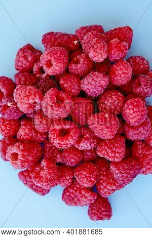 Raspberry Pattern, Blue Background, Top View\rpattern Of Ripe Red Raspberry On Blue Background. Vega