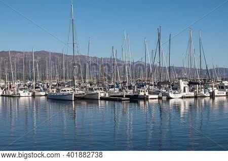 Usa, California, Santa Barbara - December 18, 2020: Many White Yachts Packed At Docks In Haror Under