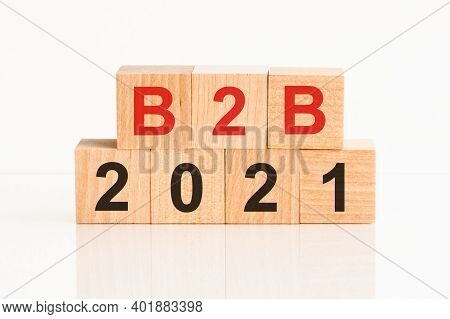 B2b 2021 Word Written On Wood Block. Faqs Text On Table, Concept. B2b - Business-to-business