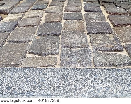 Perspective View Of Stone Pavement Texture. Cobbled Granite Pavement Background, Regular Shapes Of C