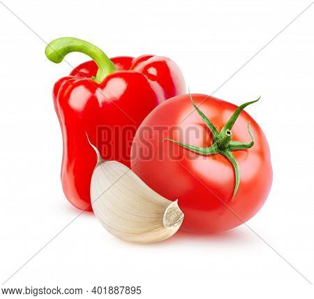 Isolated Raw Vegetables. Fresh Tomato, Red Bell Pepper And Clove Of Garlic Isolated On White Backgro
