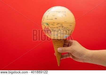 Ice Cream Cone Made Of A Globe  Concept Of Overusing The Resource Of Nature