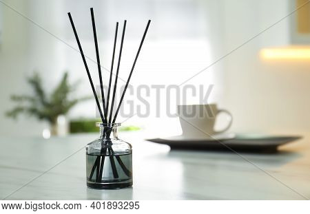 Aromatic Reed Air Freshener On White Table Indoors. Space For Text