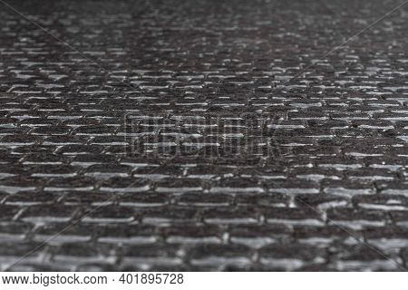 Snowy Sleet Road, Icy Road, Ice. Footpath In The City Winter Frozen Of Ice And Snow Is Slippery. The