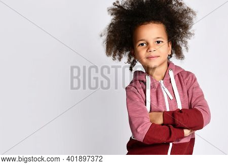Studio Shot Of Small Cute African American Black Skin Girl Model With Curly Hair In Sportswear, Arms