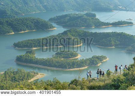 Hong Kong, China - 18 December, 2020 :  Hiker On Reservoir Islands Viewpoint In Tai Lam Chung Reserv