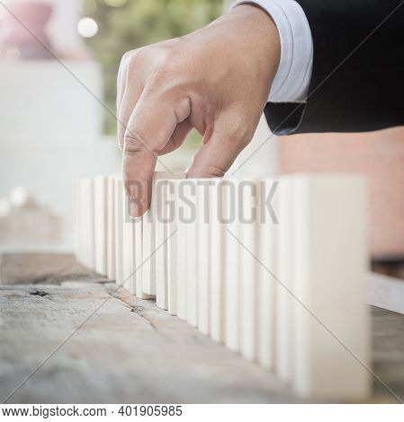 Policy Management Concept: Businessman Choosing The Wood Block