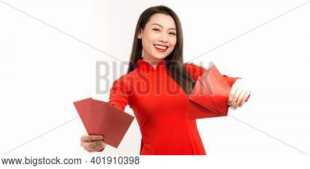 Asian Girl In Traditional And Take Red Envelopes Lunar New Year, Concept Celebrating Lunar New Year