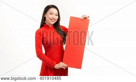 Portrait Of A Beautiful Asian Woman On Traditional Festival Costume Ao Dai Showing New Year Scrolls