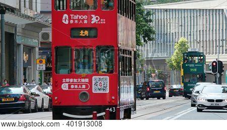 Wan Chai, Hong kong 06 September 2020: Street in Hong Kong, tram moving in the traffic road
