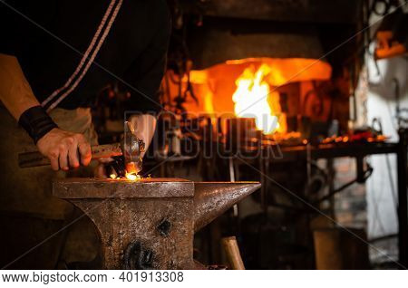 Detail Shot Of Metal Being Worked At A Blacksmith Forge, Blacksmith Working On Metal On Anvil At For
