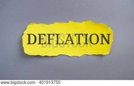 Deflation Word Written On Yellow Paper. Concept Meaning Decrease In The General Price Level Of Goods