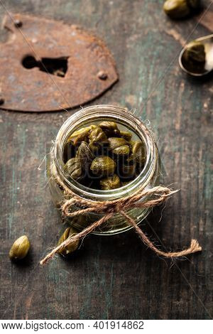 Capers Marinated Capers In A Jar On Dark Background. Delicious Ingredients For Cooking Mediterranean