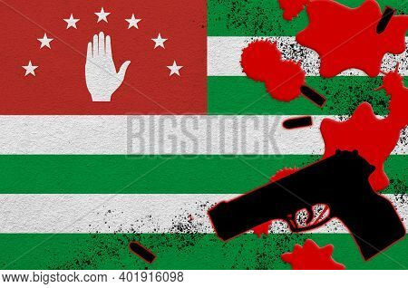 Abkhazia Flag And Black Firearm In Red Blood. Concept For Terror Attack Or Military Operations With