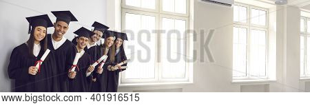 Banner With Happy Graduates Holding Diplomas And Smiling In University Hall With Big Windows
