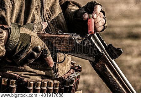 Male Hunter In Ready To Hunt. Closeup. Hunter Man. Hunting Period. Male With A Gun, Rifle. Man Is Ch
